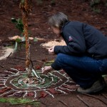 Deb adds a few pieces to the mandala that she collected while foraging amongst the cedars and pines.
