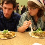 Kristen and Andrew eat a delicious meal prepared by volunteers at the Real Food Convergence.