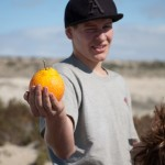 Genesis holds an orange up to the camera, one of our breakfast staples while traveling in Mexico.