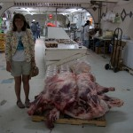 Kristen visits the market (el Mercado) in Guerrero Negro and poses beside a side of beef.