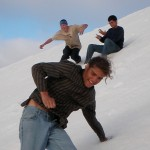 Genesis, Alex and Forest slide down a towering salt mountain at the Salt Exporter in Guerrero Negro.