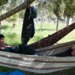 Alex and Genesis rest in hammocks in Ensenada.  Finding the Good camped at a spiritual center and were hosted by the gracious Oscar and Marcela.